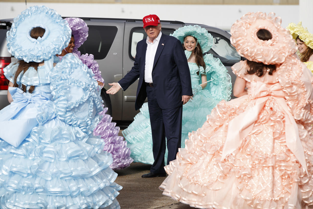 <p>President-elect Donald Trump is greeted by the Azalea Trail Maids after arriving at the airport for a rally at Ladd-Peebles Stadium, Saturday, Dec. 17, 2016, in Mobile, Ala. (Photo: Evan Vucci/AP) </p>
