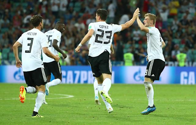 Soccer Football - World Cup - Group F - Germany vs Sweden - Fisht Stadium, Sochi, Russia - June 23, 2018 Germany's Marco Reus celebrates scoring their first goal with Mario Gomez and Jonas Hector REUTERS/Michael Dalder