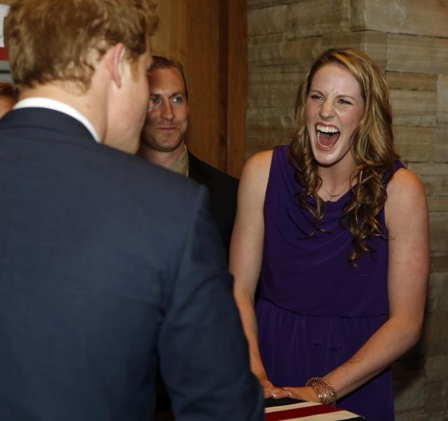 SEDALIA, CO - MAY 10: Olympic gold medalist Missy Franklin (R) laughs as she talks with HRH Prince Harry at a reception at the Sanctuary Golf Course on May 10, 2013 in Sedalia, Colorado. HRH will be undertaking engagements on behalf of charities with which the Prince is closely associated on behalf also of HM Government, with a central theme of supporting injured service personnel from the UK and US forces. (Photo by Ed Andrieski - Pool/Getty Images)