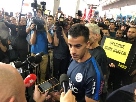 Hakeem al-Araibi, a refugee Bahraini footballer who was released from a Thai prison, talks to the media as he arrives at the airport in Melbourne, Australia February 12, 2019 in this picture obtained from social media.  Australian Council of Trade Unions/via REUTERS