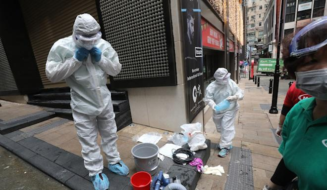 The city's nightlife heartland of Lan Kwai Fong was disinfected on Friday after the area was linked with confirmed Covid-19 cases. Photo: Dickson Lee