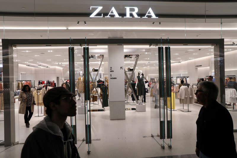 FILE PHOTO: People shop at a Zara store during the grand opening of The Hudson Yards development in New York