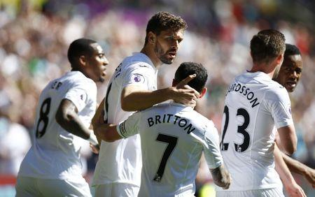 Britain Soccer Football - Swansea City v Stoke City - Premier League - Liberty Stadium - 22/4/17 Swansea City's Fernando Llorente celebrates scoring their first goal with Leon Britton Action Images via Reuters / Peter Cziborra Livepic