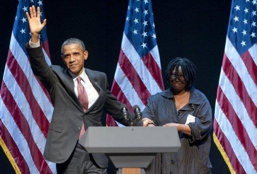 """US President Barack Obama greets actress Whoopi Goldberg (R) prior to speaking following a special fundraising performance of the Broadway musical """"Sister Act"""" on behalf of the Democratic National Committee at the Broadway Theatre in New York, June 23, 2011. AFP PHOTO / Saul LOEB"""