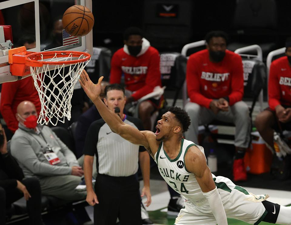 Giannis Antetokounmpo #34 of the Milwaukee Bucks goes up for a shot against Clint Capela #15 of the Atlanta Hawks during the second half in game two of the Eastern Conference Finals at Fiserv Forum on June 25, 2021 in Milwaukee, Wisconsin. NOTE TO USER: User expressly acknowledges and agrees that, by downloading and or using this photograph, User is consenting to the terms and conditions of the Getty Images License Agreement. (Photo by Stacy Revere/Getty Images)