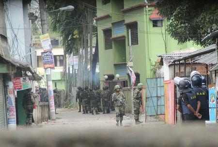 Armed para-commandos cordon an area during an operation against militants in Sylhet