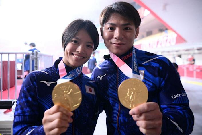 """Japan's Hifumi Abe, the gold medallist of the judo men's -66kg contest of the Tokyo 2020 Olympic Games, and his sister Uta Abe, the gold medallist of the judo women's -52kg contest of the Tokyo 2020 Olympic Games, pose with their medals before the final block of the day three of judo competition during the Tokyo 2020 Olympic Games at the Nippon Budokan in Tokyo on July 26, 2021.<span class=""""copyright"""">Franck Fife—AFP via Getty Images</span>"""