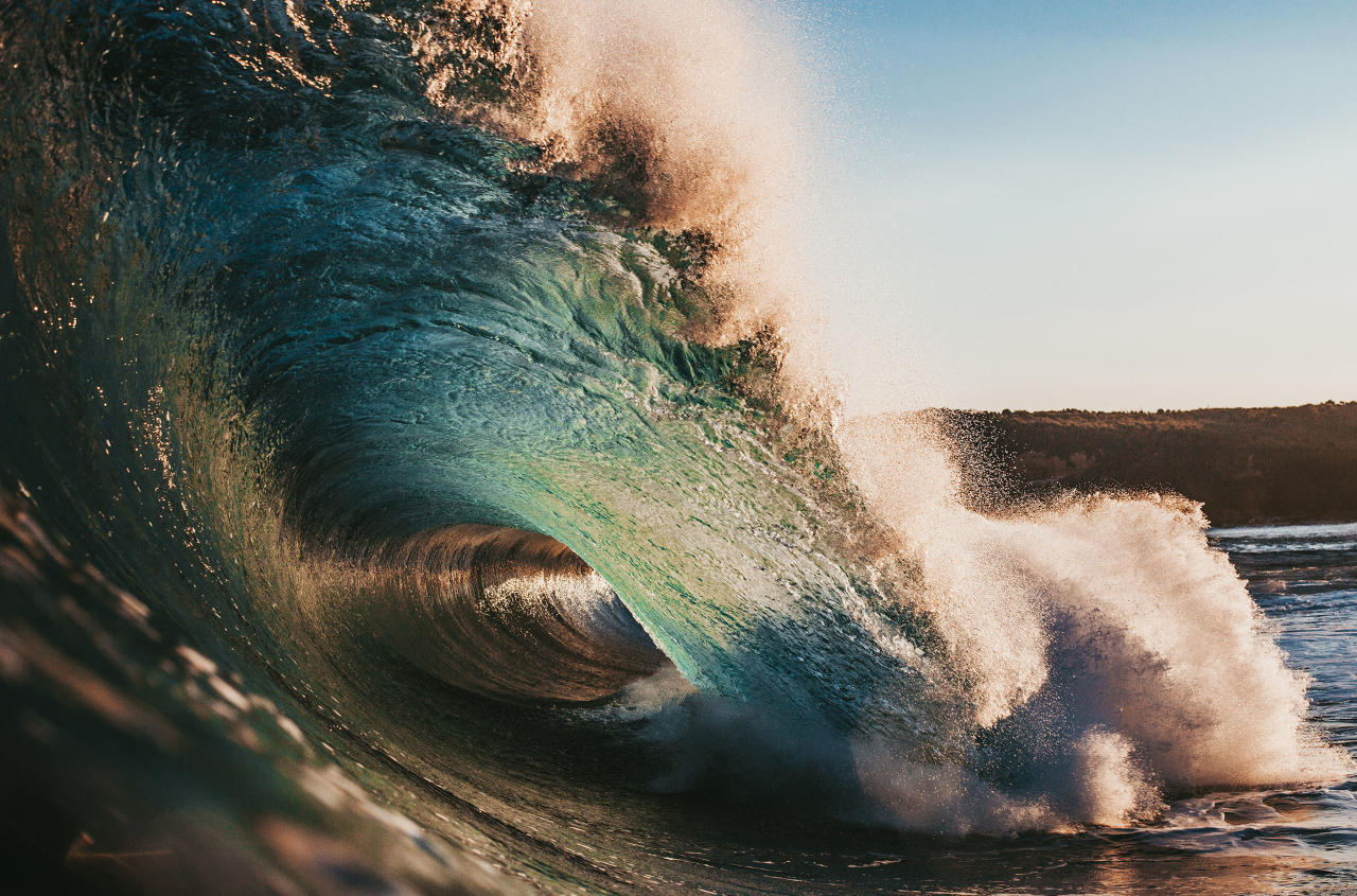 <p>These kaleidoscopic images are the work of one persistent photographer's efforts to capture vibrant hues at the exact moment a wave breaks. (Photo: Ryan Pernofski/Caters News) </p>