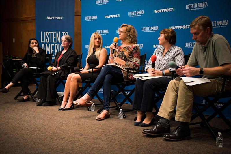 """Moderator Rebecca Kleinlistens to panelists Laurie Johnson, Beth Bearman, Anne Duff, Karen Francisco and Mark Berends during the """"Vouchers: The Economics and Academics of Choice"""" discussion."""