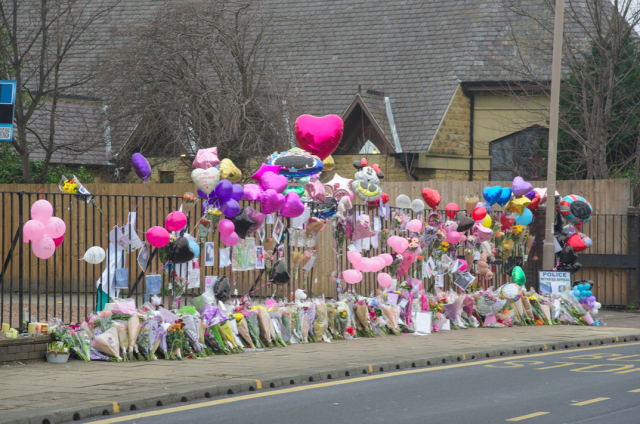 Tributes left at the scene of the crash after Katelyn's death (SWNS)