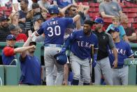 Texas Rangers' Nathaniel Lowe (30) celebrates after scoring on a two-run ground-rule double by Andy Ibanez during the ninth inning of a baseball game against the Boston Red Sox, Monday, Aug. 23, 2021, in Boston. (AP Photo/Michael Dwyer)
