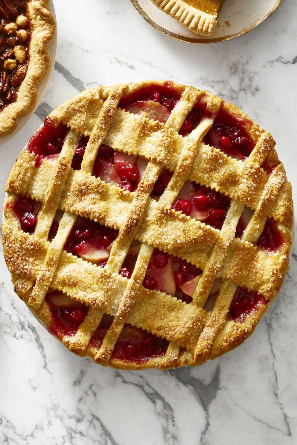 """<p>Alternate thick and thin strips of pie dough for a unique lattice pattern that's almost too pretty to eat ... almost.</p><p><em><a href=""""https://www.goodhousekeeping.com/food-recipes/dessert/a46629/cranberry-pear-lattice-pie-recipe/"""" rel=""""nofollow noopener"""" target=""""_blank"""" data-ylk=""""slk:Get the recipe for Cranberry-Pear Lattice Pie »"""" class=""""link rapid-noclick-resp"""">Get the recipe for Cranberry-Pear Lattice Pie »</a></em></p><p><strong>RELATED: </strong><a href=""""https://www.goodhousekeeping.com/holidays/thanksgiving-ideas/g29192000/cranberry-desserts/"""" rel=""""nofollow noopener"""" target=""""_blank"""" data-ylk=""""slk:18 Easy Cranberry Dessert Ideas to Wow Your Friends"""" class=""""link rapid-noclick-resp"""">18 Easy Cranberry Dessert Ideas to Wow Your Friends</a><br></p>"""