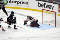 Los Angeles Kings center Anze Kopitar (11) scores past Anaheim Ducks goaltender Anthony Stolarz during the second period of an NHL hockey game Tuesday, April 20, 2021, in Los Angeles. (AP Photo/Marcio Jose Sanchez)