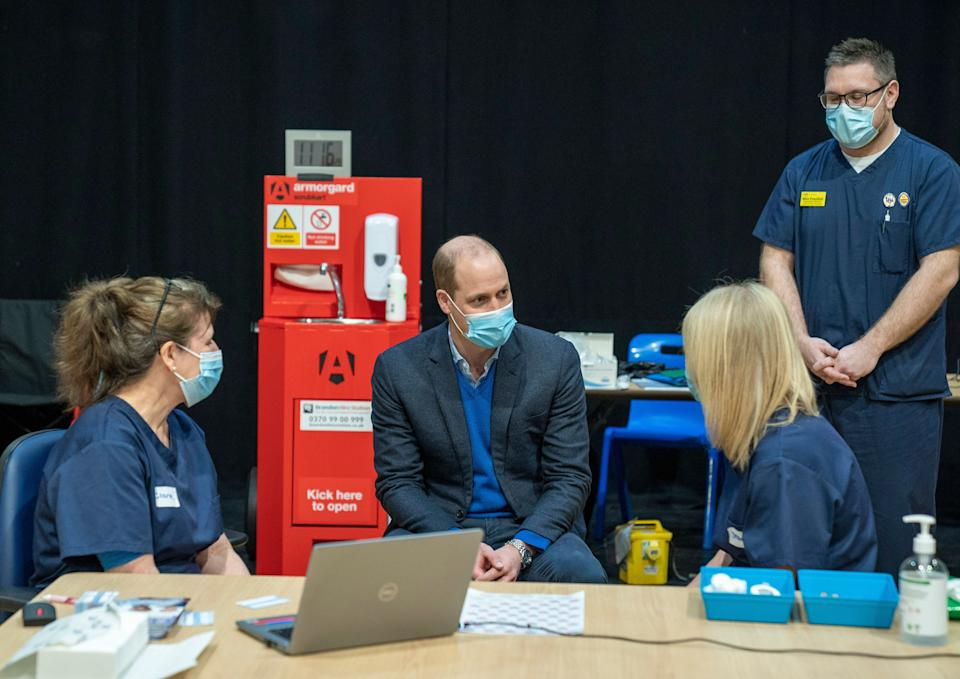 Prince William visits King's Lynn Corn Exchange Vaccination Centre on Feb. 22 in King's Lynn, England. The duke spoke to NHS staff and volunteers and heard more about their experiences of being involved in the vaccination program. (Photo: WPA Pool via Getty Images)