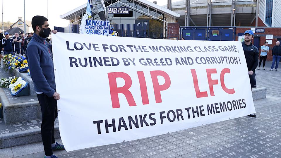 Pictured here, football fans protest the Super League outside Elland Road.