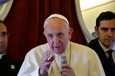 Pope Francis addresses reporters aboard the plane bringing him back following a two-day trip to Morocco