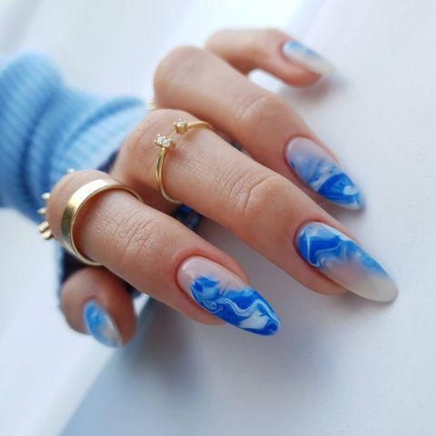 "<p>Bring the beach to you with wave-inspired blue nail art.</p><p><a href=""https://www.instagram.com/p/CMy_GIaMPtZ/?utm_source=ig_embed&utm_campaign=loading"" rel=""nofollow noopener"" target=""_blank"" data-ylk=""slk:See the original post on Instagram"" class=""link rapid-noclick-resp"">See the original post on Instagram</a></p>"