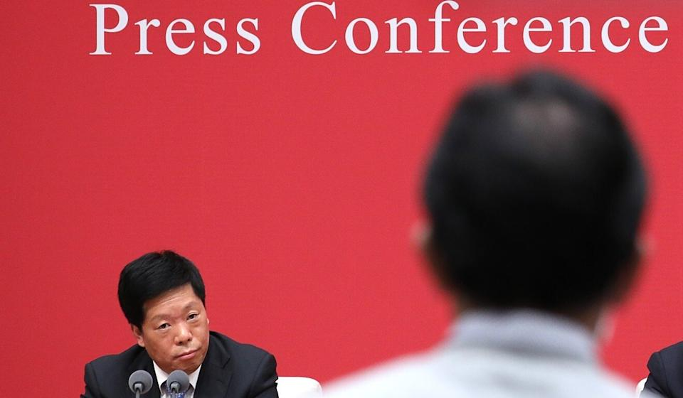 Han Wenxiu, deputy director of China's Office of the Central Finance and Economic Commission, takes a question at a Friday press conference. Photo: Simon Song