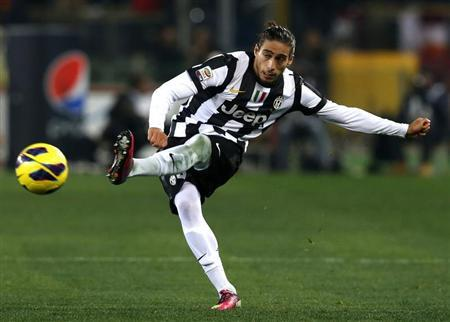 Juventus' Caceres kicks the ball during his Italian Serie A soccer match against AS Roma at the Olympic stadium in Rome
