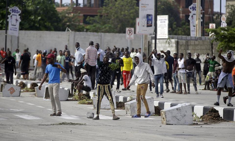 People protest at the Lekki toll gate in Lagos, Nigeria, on Wednesday.