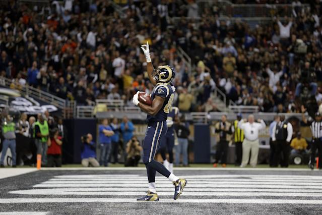St. Louis Rams tight end Jared Cook celebrates after catching a 6-yard touchdown pass during the first quarter of an NFL football game against the Chicago Bears on Sunday, Nov. 24, 2013, in St. Louis. (AP Photo/Nam Y. Huh)
