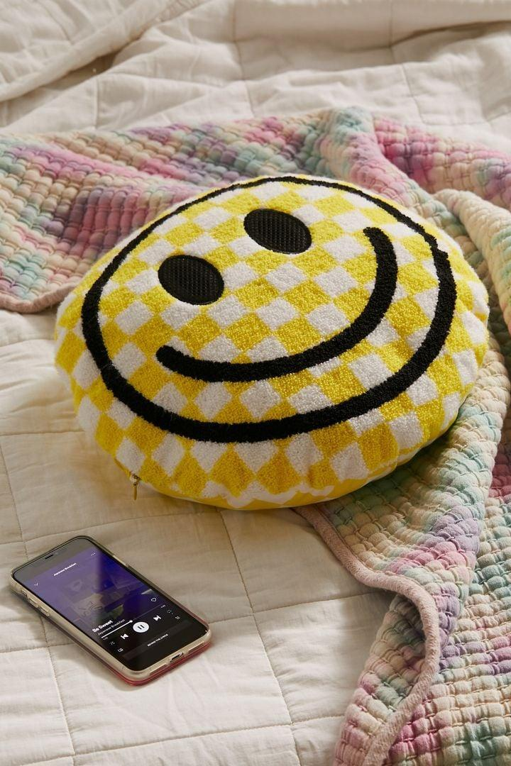 <p>This <span>Happy Face Throw Pillow Bluetooth Speaker</span> ($38) isn't just cute and cozy, but yes it plays music. The best part: maybe you can use it, too.</p>