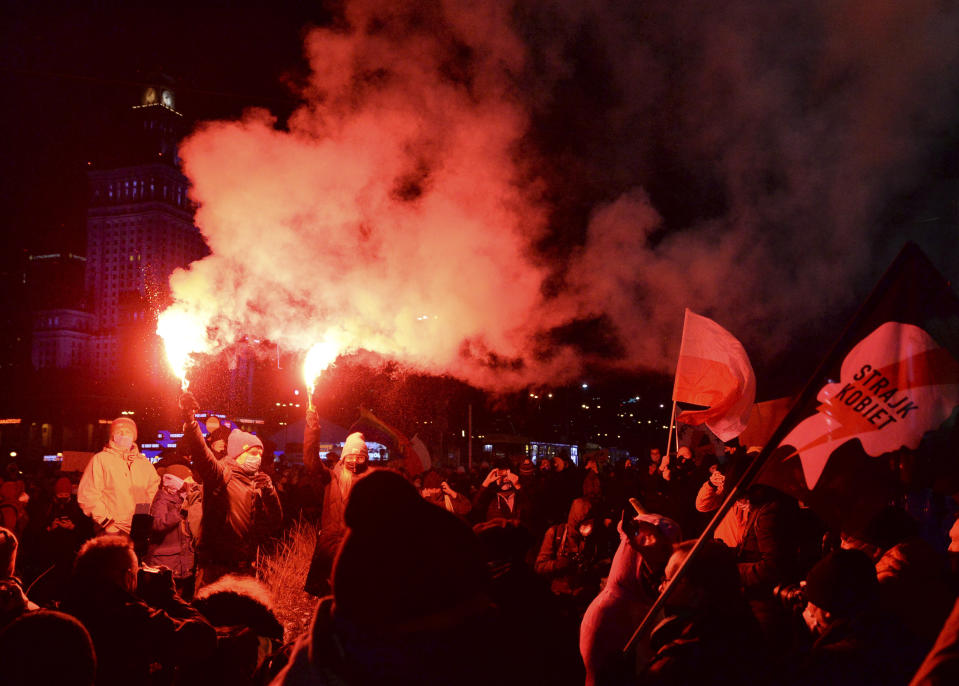 People protest against new anti-abortion laws near the ruling Law and Justice party headquarters in Warsaw, Poland, Friday, Jan. 29, 2021, after the country's top court confirmed its highly divisive ruling that will further tighten the predominantly Catholic nation's strict anti-abortion law. (AP Photo/Czarek Sokolowski)