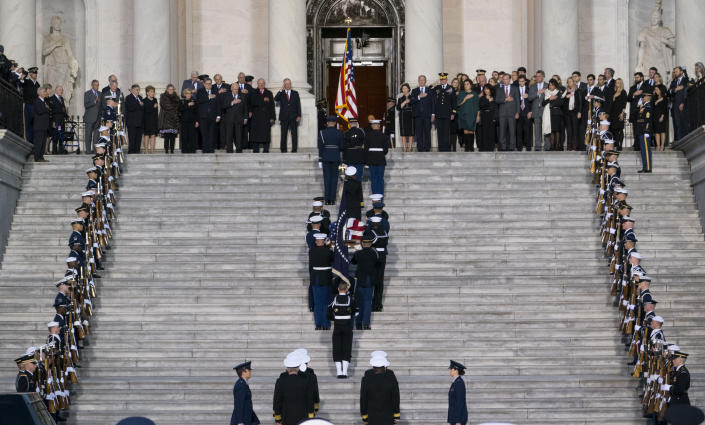 The casket carrying former president George Herbert Walker Bush is carried up the steps of the US Capitol in Washington, Monday, Nov. 3, 2018. (Photo: Doug Mills/The New York Times/Pool via Getty Images)