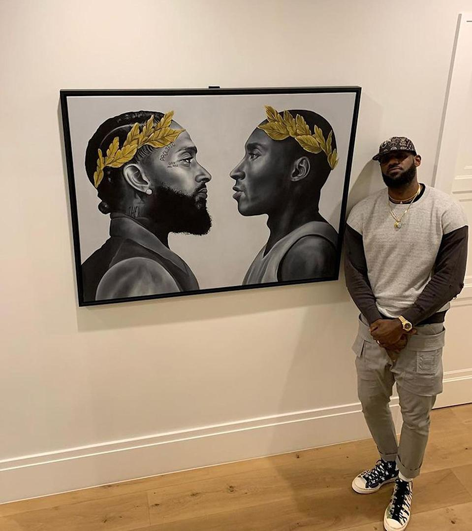 """<p>The NBA star is memorializing two of his late heroes — Nipsey Hussle and Kobe Bryant — with a new art piece in his home. """"Wit me every single day when walking my hallways,"""" <a href=""""https://www.instagram.com/p/CLa6hSUAKpL/"""" rel=""""nofollow noopener"""" target=""""_blank"""" data-ylk=""""slk:he wrote"""" class=""""link rapid-noclick-resp"""">he wrote</a>.</p>"""
