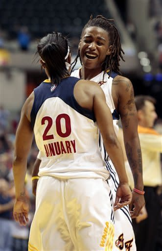 Indiana Fever guard Shavonte Zellous, right, celebrates after teammate Briann January is fouled during the fourth quarter while playing the Atlanta Dream in a WNBA basketball first-round playoff game in Indianapolis, Tuesday, Oct. 2, 2012. The Fever won 75-64. (AP Photo/AJ Mast)