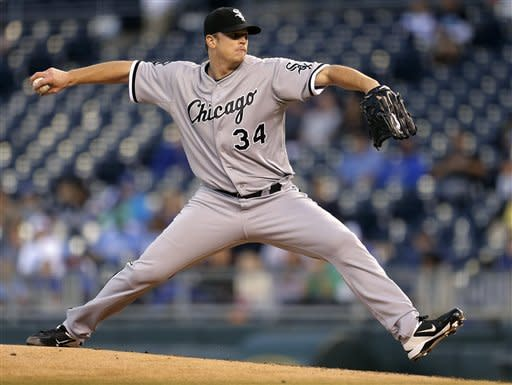 Chicago White Sox starting pitcher Gavin Floyd throws during the first inning of a baseball game against the Kansas City Royals, Tuesday, Sept. 18, 2012, in Kansas City, Mo. (AP Photo/Charlie Riedel)