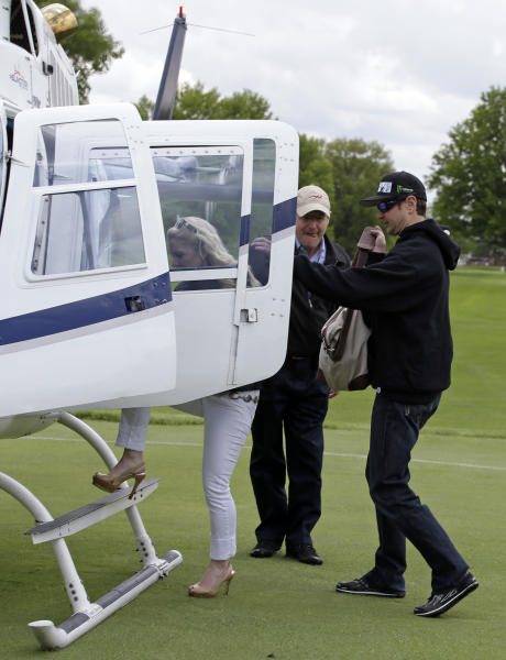 Kurt Busch boards a helicopter to begin his trip to Charlotte for tonight's NASCAR race after he qualified on the first day of qualifications for Indianapolis 500 IndyCar auto race at the Indianapolis Motor Speedway in Indianapolis, Saturday, May 17, 2014. (AP Photo/Darron Cummings)