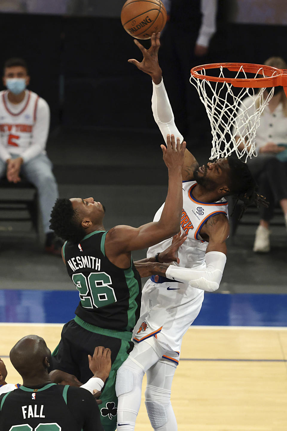 New York Knicks center Nerlens Noel (3) blocks a shot by Boston Celtics forward Aaron Nesmith (26) during the first half of an NBA basketball game in New York, Sunday, May 16, 2021. (Vincent Carchietta/Pool Photo via AP)