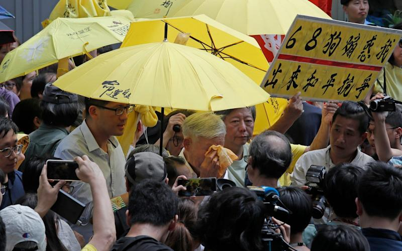 Occupy Central leader Chu Yiu-ming cried as he spoke to the media after sentencing on Wednesday - AP