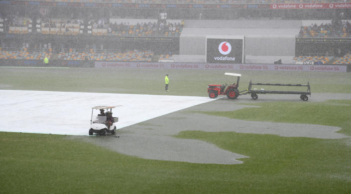 Rain stops play on day two of the fourth cricket test between India and Australia at the Gabba, Brisbane, Australia, Saturday, Jan. 16, 2021. (AP Photo/Tertius Pickard)
