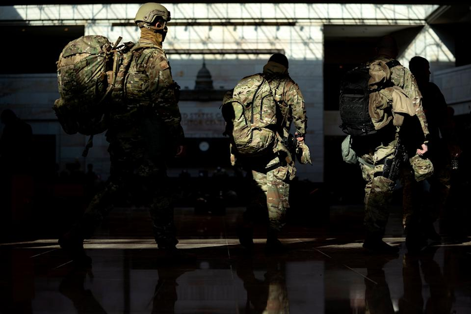 WASHINGTON, DC - JANUARY 13: Members of the National Guard walk through the Visitor Center of the U.S. Capitol on January 13, 2021 in Washington, DC. Security has been increased throughout Washington following the breach of the U.S. Capitol last Wednesday, and leading up to the Presidential inauguration. (Photo by Stefani Reynolds/Getty Images) (Photo: Stefani Reynolds via Getty Images)