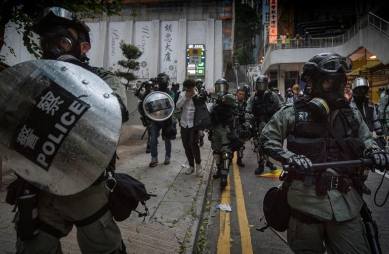 A Hong Kong judge says police were wrong to hide their ID badges during last year's protests