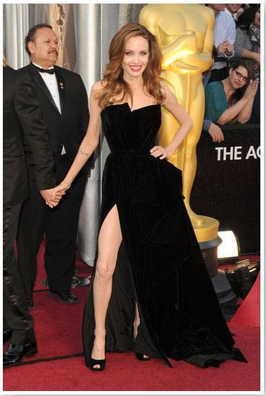 """<div class=""""caption-credit""""> Photo by: FabSugar</div><div class=""""caption-title"""">Angelina Jolie</div>Angelina Jolie showed off major red-carpet glamour in a black high-slit gown by Versace Atelier. <br>"""