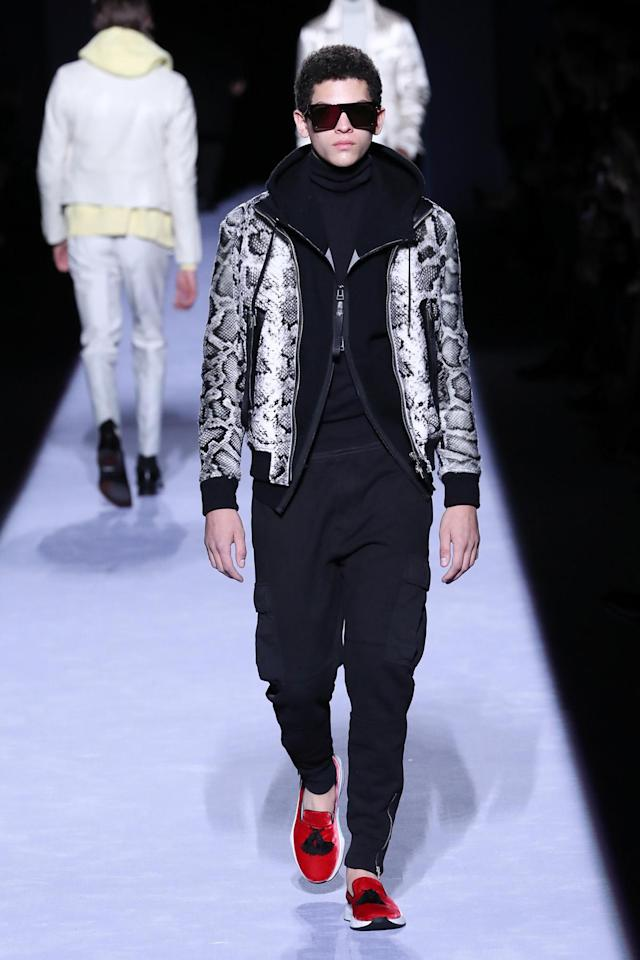 <p>A model wears a hybrid between a slipper and a sneaker to complement his fashion forward athleisure look, all desgined by Tom Ford. (Photo: Getty Images) </p>