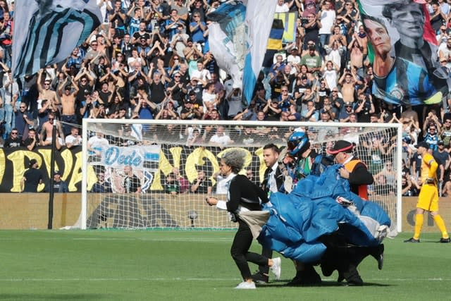 A parachutist landed on the pitch during Sunday's Serie A match between Sassuolo and Inter Milan just before Romelu Lukaku took a penalty (Elisabetta Baracchi/AP)