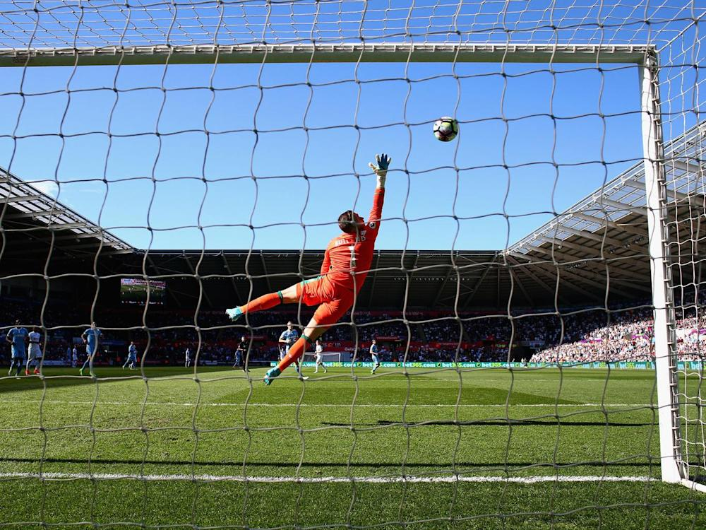 Jack Butland reaches in vain to stop Carroll's strike (Getty)