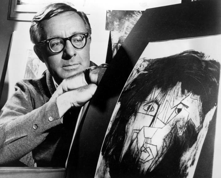 Science fiction writer Ray Bradbury looks at a picture that was part of a school project to illustrate characters in one of his dramas in Hollywood, Ca., Dec. 8, 1966. (AP Photo)