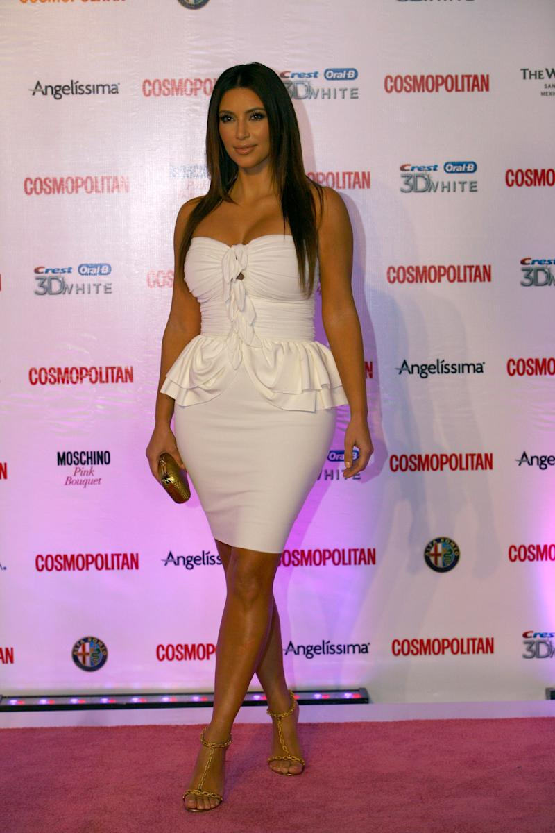 Television personality Kim Kardashian poses for photographers at the red carpet during the 40th anniversary of Cosmopolitan magazine in Spanish in Mexico City, Thursday Oct. 4, 2012. (AP Photo/Marco Ugarte)