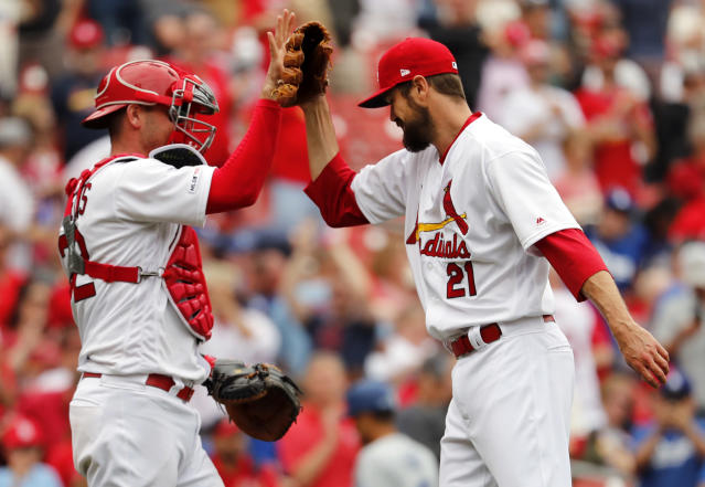 St. Louis Cardinals relief pitcher Andrew Miller, right, and catcher Matt Wieters celebrate an 11-7 victory over the Los Angeles Dodgers after a baseball game Thursday, April 11, 2019, in St. Louis. (AP Photo/Jeff Roberson)