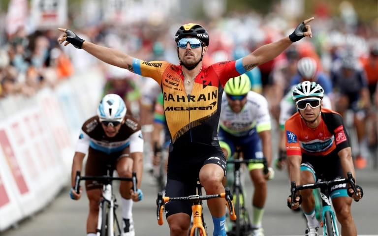 Italy's Sonny Colbrelli of team Bahrain-Mclaren celebrates after taking the second stage of the Route d'Occitanie