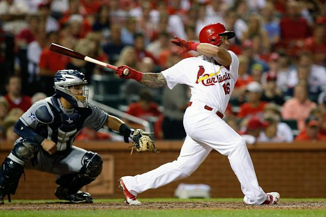 St. Louis Cardinals' Kolten Wong follows through on a RBI single to score Jon Jay during the fourth inning of a baseball game against the San Diego Padres Friday, Aug. 15, 2014, in St. Louis. (AP Photo/Scott Kane)