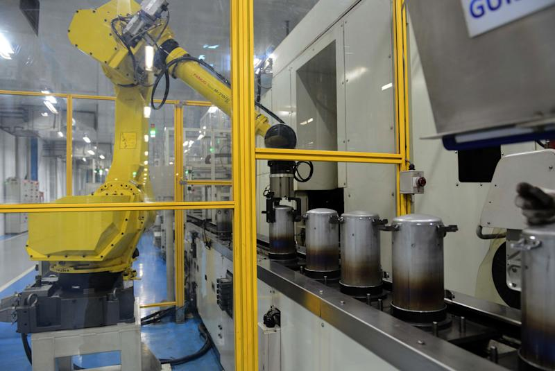 In this photograph taken on December 8, 2016, an automated robot works on an assembly line of Highly Electrical Appliances India Pvt. Ltd. at a company air-conditioner compressor plant at Matoda, some 20 kms. from Ahmedabad. / AFP / SAM PANTHAKY (Photo credit should read SAM PANTHAKY/AFP via Getty Images)