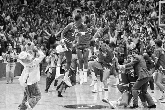 <p>The legend of then-NC State head coach Jim Valvano all started with this unthinkable tourney performance. The Wolfpack entered the 52-team tournament as a No. 6 seed and needed 69-67 double overtime win just to beat Pepperdine in the first round. That set the stage for a series of narrow wins, including a 63-62 squeaker over 1-seeded Virginia in the regional final and a memorable 54-52 triumph over a mighty Houston team led by Hakeem Olajuwon and Clyde Drexler. Valvano's crew won it all on a famous play where a badly missed desperation 3-pointer led to Lorenzo Charles' putback slam at the buzzer. </p>