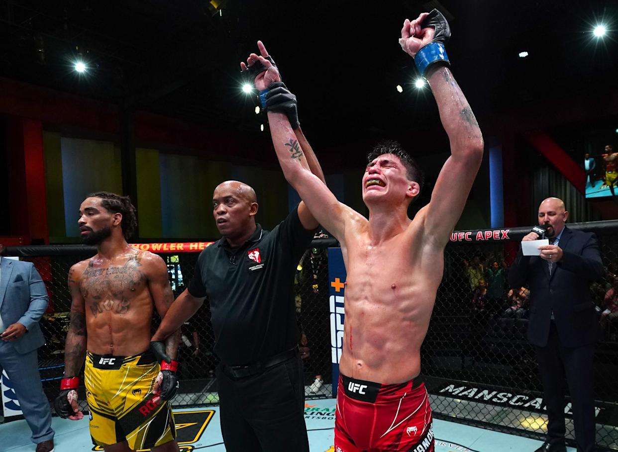 Ignacio Bahamondes of Chile reacts after his knockout victory over Roosevelt Roberts