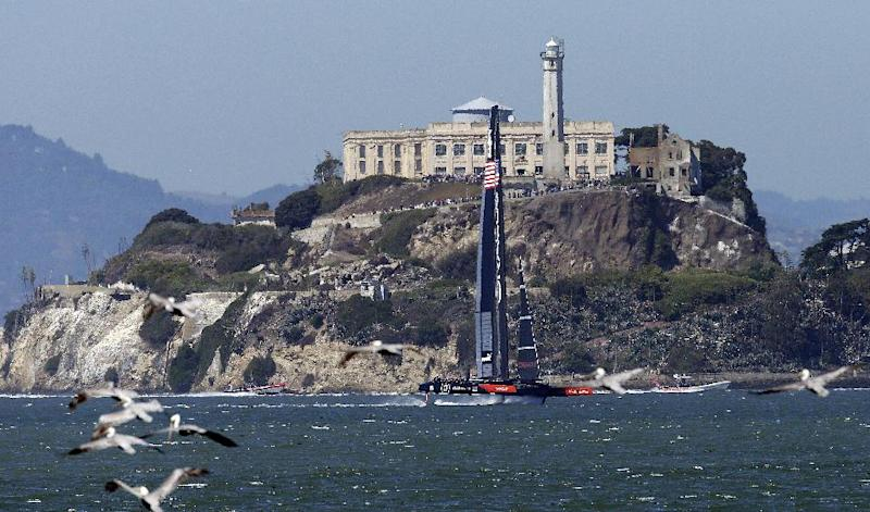 Oracle Team USA races past Alcatraz Island during the 12th race of the America's Cup sailing event against Emirates Team New Zealand, Thursday, Sept. 19, 2013, in San Francisco. (AP Photo/Ben Margot)